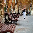Girl Jogging in Barcelona Park by Carlos Lorenzo