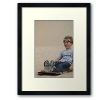 Goggles in the Sand Framed Print