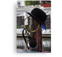 bowler hat and horn on canal boat Canvas Print