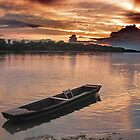 Boat on the river Danube at sunset by robertpatrick