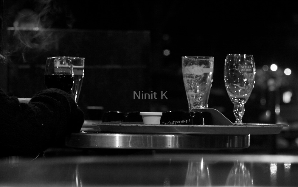 Empty glasses, drinks and a smoking cigarette by Ninit K