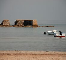 Crumbling Sea Wall with Two Boats  by jojobob