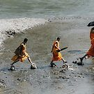 Monks crossing the creek by Pierre Vandewalle