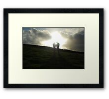 silhouetted lovers Framed Print