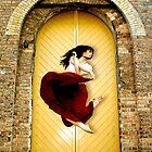 Dancer in red dress in front of yellow door by bradlentz-photo