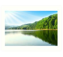 Summer emerald lake with blue sky and sun rays. Art Print