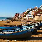 Blue fishing boats in Ahrud near Agadir, Morocco by Bruno Beach