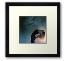 the storm against the light Framed Print