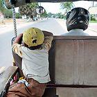 Boy at back of Tuk Tuk - Cambodia by biancamarks