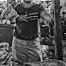 Chicken man - Lower Market, Bukittingi, Sumatra Indonesia by Naomi Brooks