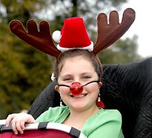 Its Rudolph, Its Bozo, Its a girl with a big red nose by Bill Gamblin