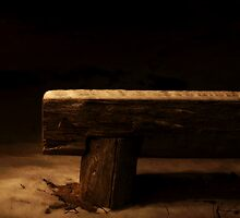 Empty bench in the darknes by Arve Bettum