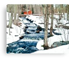 Waterfall cascading down snowy slope. New England winter scene Canvas Print