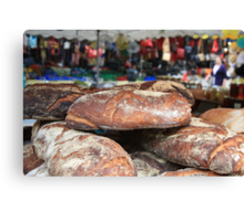 Market Series - Crustry bread with colourful backdrop Canvas Print