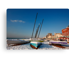 Snowy seafront Canvas Print