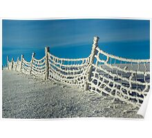 Snowy fence against cold blue sky Poster