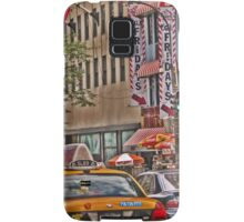 Cabs stream past TGI Fridays on 5th Ave Samsung Galaxy Case/Skin