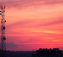 Cellular tower at sunset by vladromensky