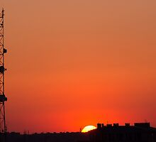 Cell tower at sunset by vladromensky