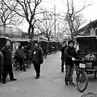 Rickshaw family by Ruben D. Mascaro
