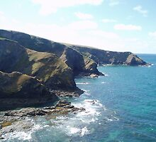 Dark Rocks v Blue Waves. by Clickerpic