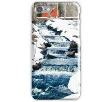 Waterfall cascading down snowy slope. New England winter scene iPhone Case/Skin