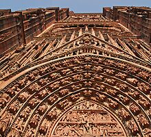 The pinky-red facade of the Strasbourg Cathedral  by roumen