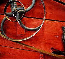 flywheel on red peanut picker by Mark Malinowski