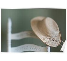 A Chair and a Straw Hat Poster