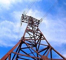 High-voltage tower on blue sky by vladromensky