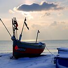 Fishing boat in the snow by mikebov