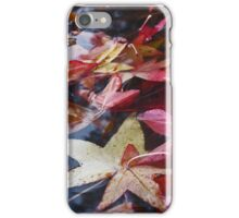 fall leafs sitting in a puddle iPhone Case/Skin