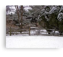 Wooden Fence in Snow Canvas Print