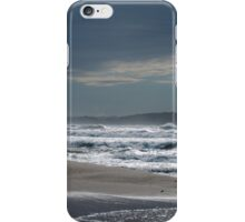 Figure silhouetted on a beach in Sardinia, Italy iPhone Case/Skin