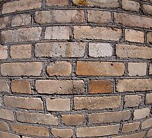 Old wall from gray and brown bricks by vladromensky