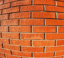 New wall of decorative red bricks close up by vladromensky