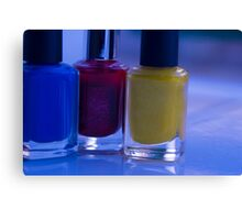 Close up of blue, red and yellow nail polish Canvas Print