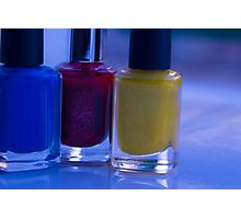 Close up of blue, red and yellow nail polish Photographic Print