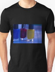 Close up of blue, red and yellow nail polish Unisex T-Shirt