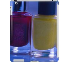 Close up of blue, red and yellow nail polish iPad Case/Skin