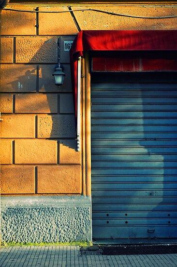 Closed shop door at sunset by Silvia Ganora