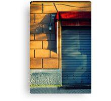 Closed shop door at sunset Canvas Print