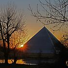 Sun sets behind a pyramid. by MarkJeremy