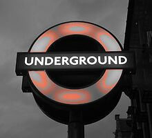 Underground sign in London by Romina .