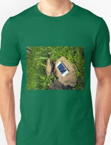 Smartphone on a rock in a meadow T-Shirt