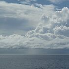 Clouds over a tranquil sea in the Whitsunday Islands by HappyMoonlight
