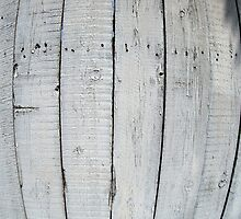 Fragment of old wooden fence painted gray by vladromensky