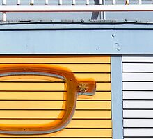 Pair of glasses on building by GiulioSaggin