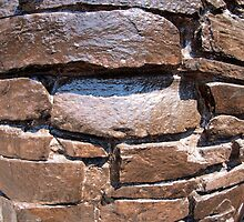The wall of the large natural stone, painted brown paint by vladromensky