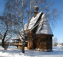 Wooden church in winter by Yulia Manko